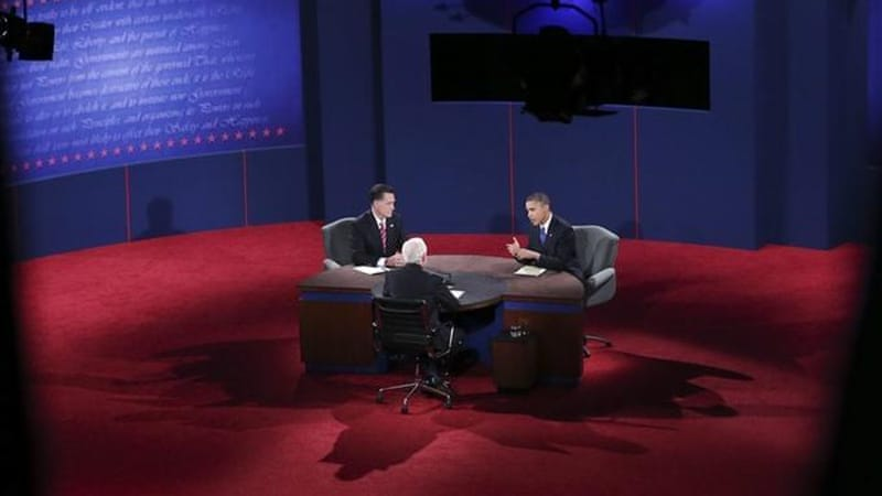 Presidential contender Mitt Romney spent much of the debate agreeing with President Barack Obama [EPA]