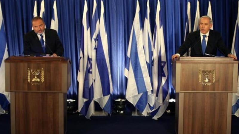Lieberman, left, is running on a joint party platform with Prime Minister Binyamin Netenyahu in the January poll [EPA]