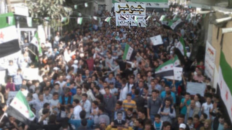 A massive anti-government protest was held in the Damascus district of Jobar [Video grab]
