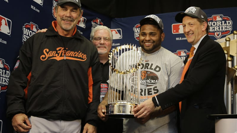 Pablo Sandoval, centre, scooped the Series MVP award, hitting .500 with three home runs, a double and four RBIs in 16 Series at-bats [EPA]