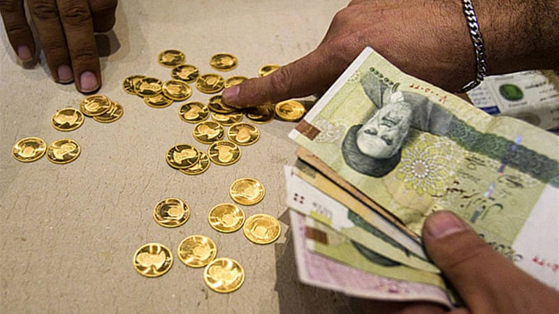 Tehran wants money changers to buy dollars at 25,000 rials, a 25 per cent boost over the going rate [Reuters]