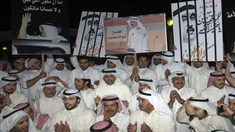 Opposition leader Musallam al-Barrack (poster) is under investigation for allegedly insulting Kuwait's emir [Reuters]