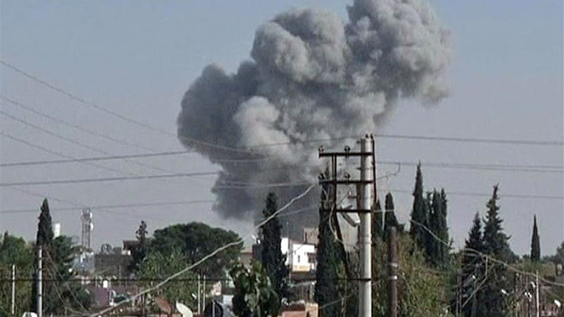 Fighter jet and helicopters have attacked rebel-held Ras al-Ain in bid to retake town near Turkey [Al Jazeera]