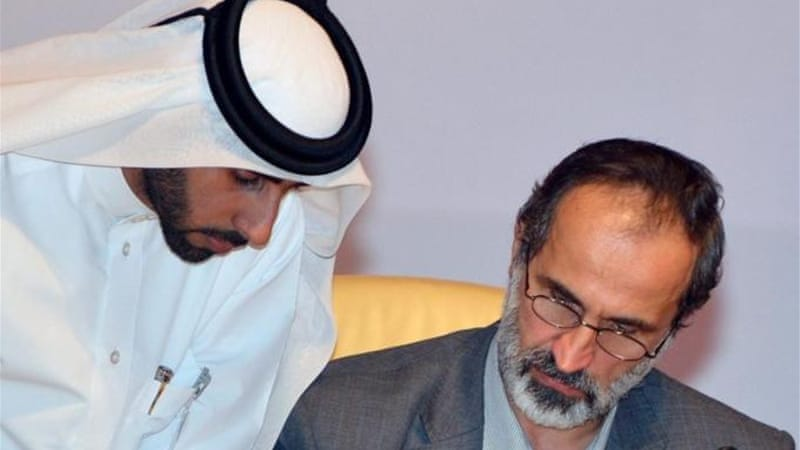 The coalition, led by Ahmad Mouaz al-Khatib, left, was formed in Qatar in November [EPA]