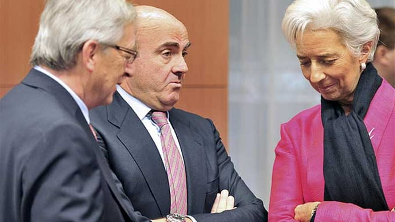 Lagarde, right, wants all prior actions contained in Greece's recently passed budget law to be actually taken [AFP]