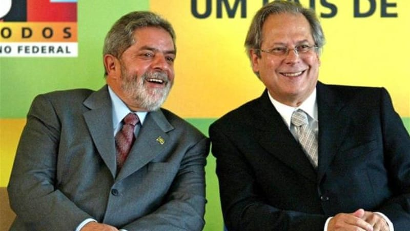 Jose Dirceu, right, was one of former president Luiz Inacio Lula da Silva's, left, closest advisers [AFP]