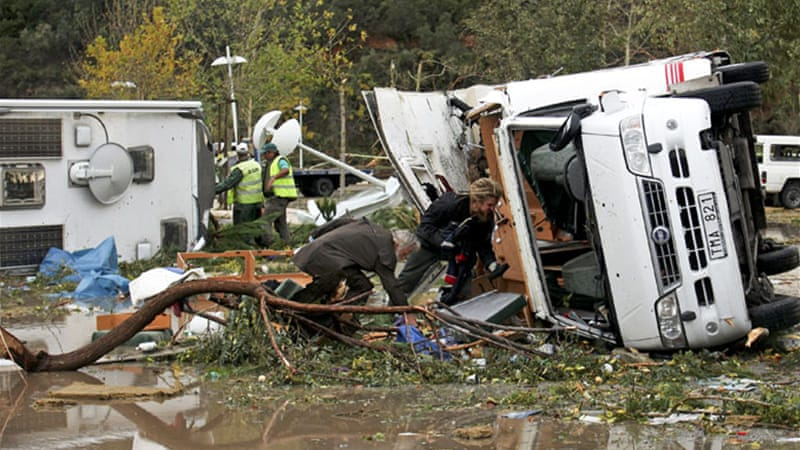 A powerful tornado hit the south of Portugal, flipping over cars and damaging a number of homes and businesses [EPA]