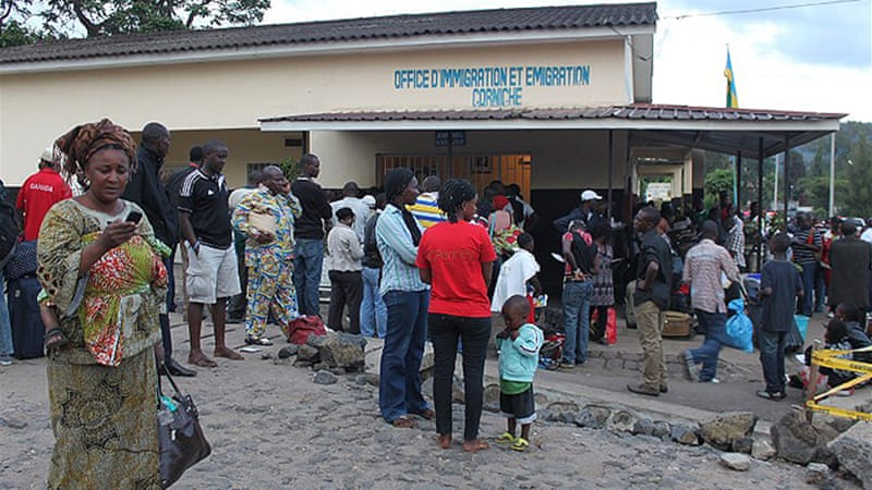 Congolese from Goma wait at immigration office in Rwandan border town of Gisenyi to leave eastern DR Congo town [AFP]