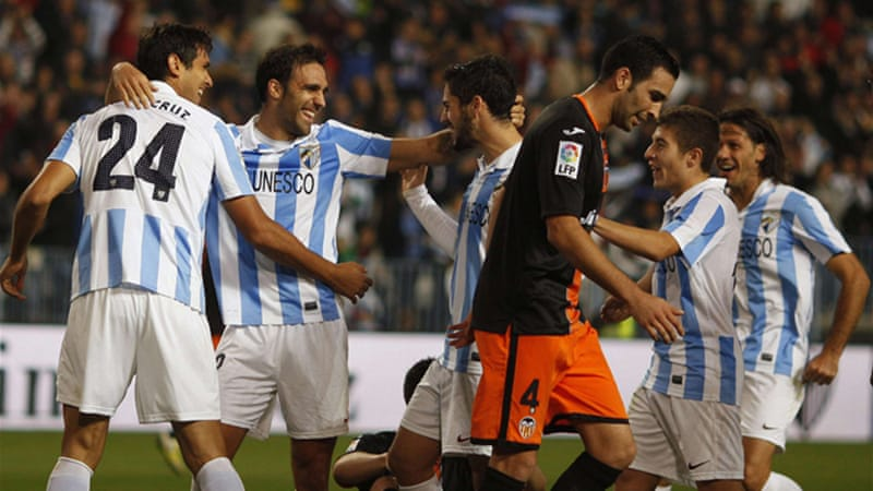 Both Malaga and Valencia qualified for the knockout stages of the Champions League earlier in the week [Reuters]
