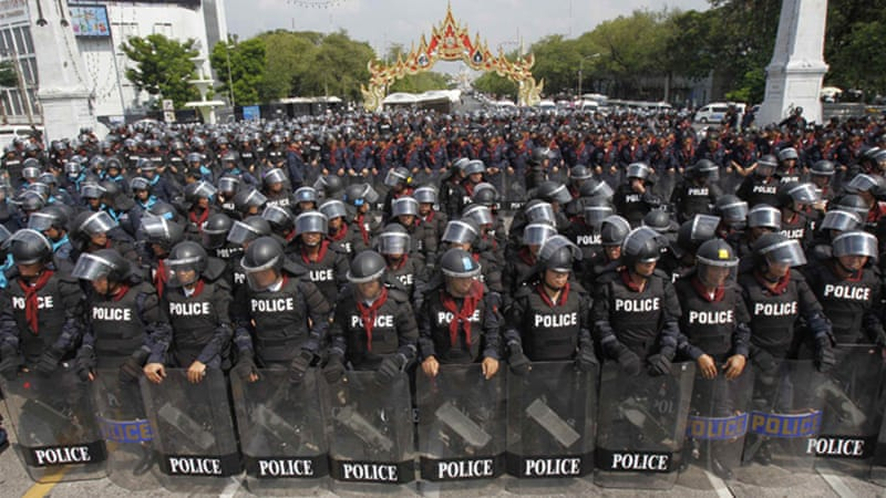 Riot police stand guard around the government house in preparation for anti-government protests [Reuters]