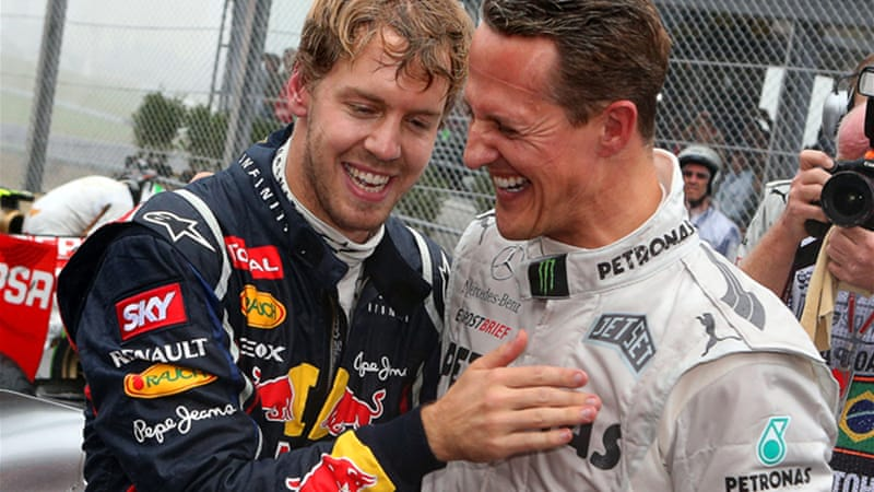 Vettel, left, becomes the third driver in history to win three successive titles, equalling the record of his childhood idol Michael Schumacher, above right, who marked his retirement with a seventh place finish at the Interlagos circuit [EPA]