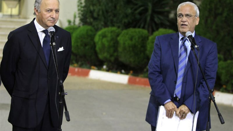 Laurent Fabius (left) recently visited Palestinian officials in Ramallah, including Chief Negotiator Saeb Erekat [AFP]