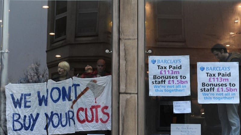 UK Uncut protested against the cuts in public expenditure and called for big firms to cover the costs of recession [AFP]