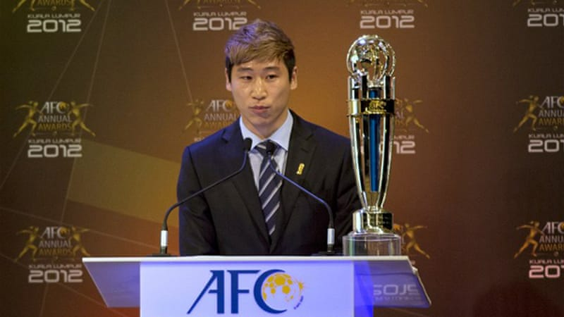 Lee edged out Iranian midfielder Ali Karimi and Chinese defender Zheng Zhi to become the first Korean to win the award [AFP]