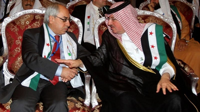 SNC chief Abdel Basset Sayda (L) meets with Syrian regime opponent Salem al-Malt (R] [Getty Images]