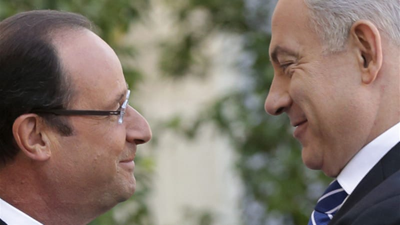 Hollande, left, reportedly said Netanyahu had transformed the Toulouse ceremony into an electoral meeting [Reuters]