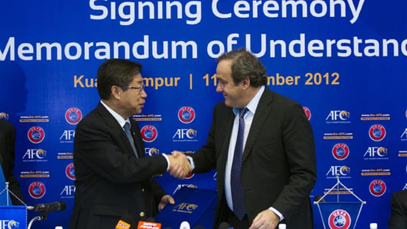 Platini is in Kuala Lumpur to sign a co-operation pact with the Asian Football Confederation to boost development of sport in the region [EPA]
