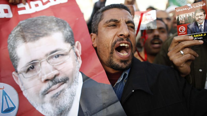 Rival rallies for and against President Morsi were once again held in Cairo on Tuesday [AFP]