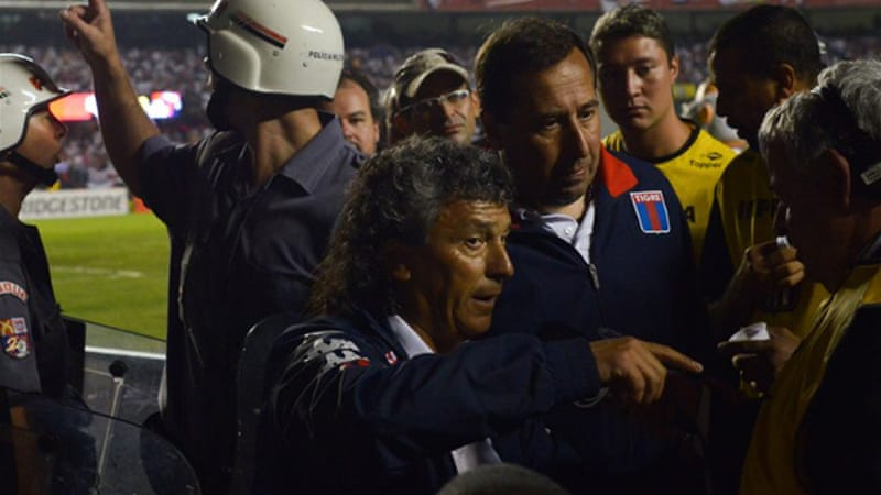 Tigre alleged they were attacked by around 20 men, followed a brawl involving players and officials as the teams left the pitch at half-time at Sao Paulo's Morumbi stadium [AFP]