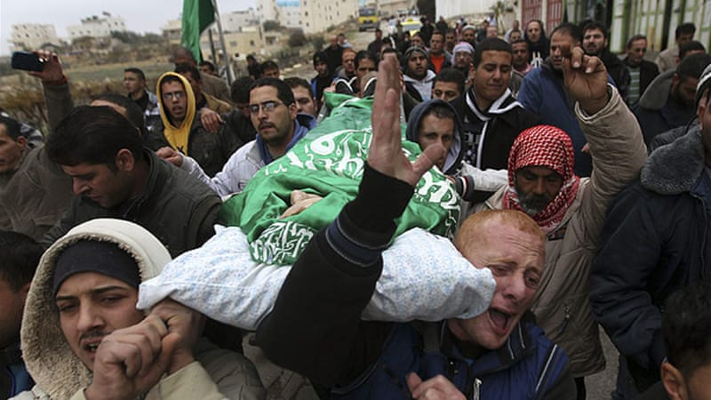 Tensions were high in Hebron during the funeral of Muhammad Ziad Awad Salaymah, killed by Israeli forces [Reuters]