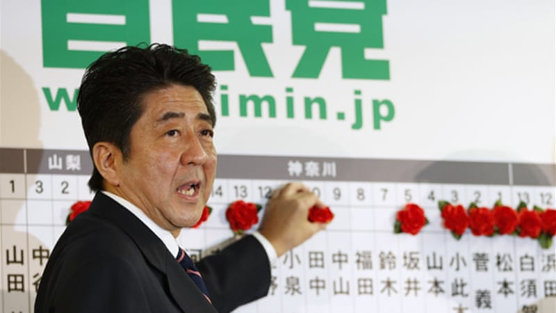 Abe says he will focus on the economy and national security amid worsening relations with China [Reuters]
