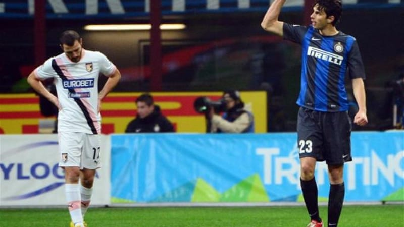 Inter defender Andrea Ranocchia (R) celebrates after Palermo's Santiago Garcia (not pictured) scores own goal [AFP]
