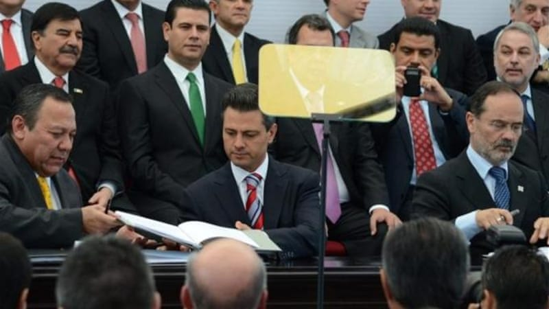 Pena Nieto, centre, and opposition leaders signed the Pact for Mexico aiming to boost competitiveness [EPA]