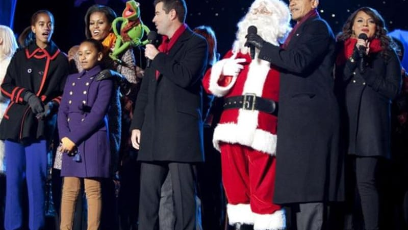 """Santa clearly has a very strong egalitarian streak... his policy of giving 'gifts' to his key constituency (children!) seems quite in line with Mitt Romney's description of Barack Obama's campaign strategy,"" says author [Reuters]"
