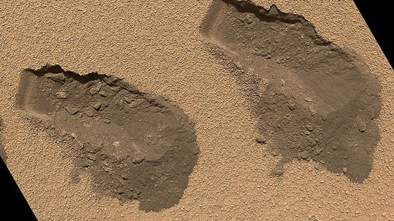 NASA Curiosity rover has found traces of some compounds like water and oxygen that are necessary for life [AFP]