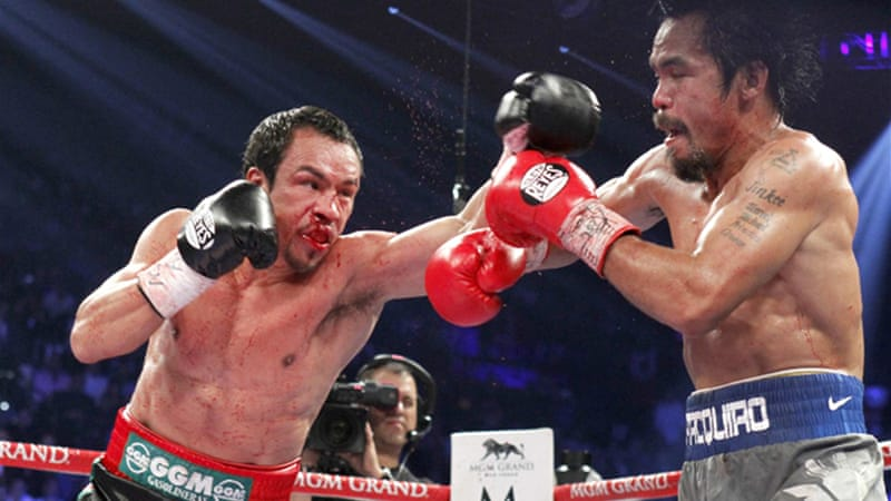 Pacquiao had been down in the third round but knocked Marquez down in the fifth before Marquez threw the 'perfect punch' that flattened the Filipino at the end of the sixth [Reuters]