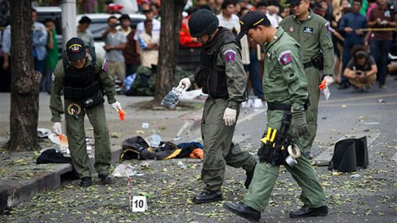 A man lost his legs and injured four others when grenades he was carrying exploded in Bangkok on Tuesday [AFP]