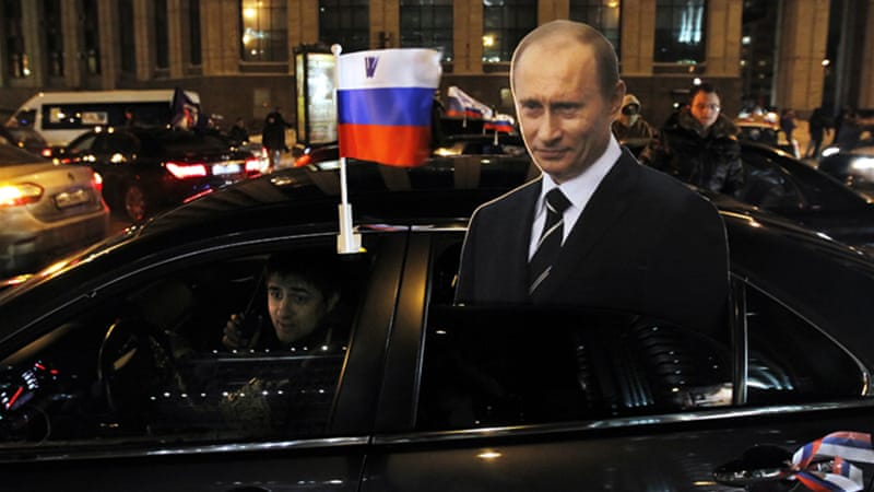 Putin's supporters in Moscow held a car rally calling for 'stability' in the governance of the country [EPA]