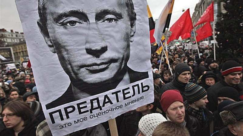 Vladimir Putin (r) will likely win the Russian presidential election, taking over from Dmitri Medvedev [EPA]