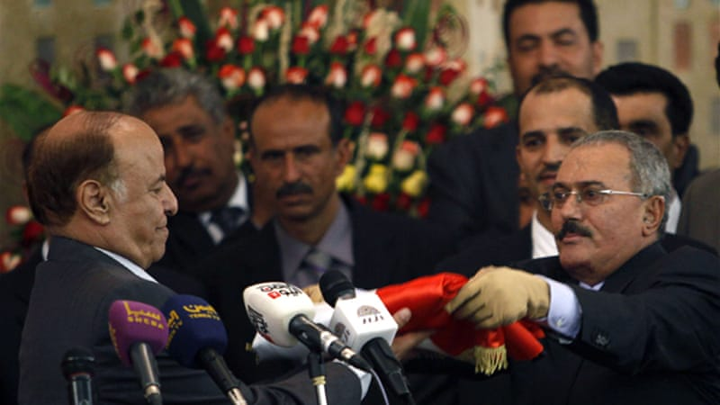 Hadi (L) took over from Ali Abdullah Saleh but many say Saleh's aides have been  blocking reforms [Reuters]