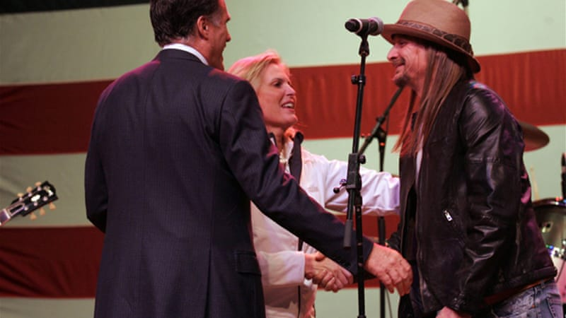 Musician Kid Rock, right, greets Romney and his wife Ann after performing during a concert in Michigan [Reuters]