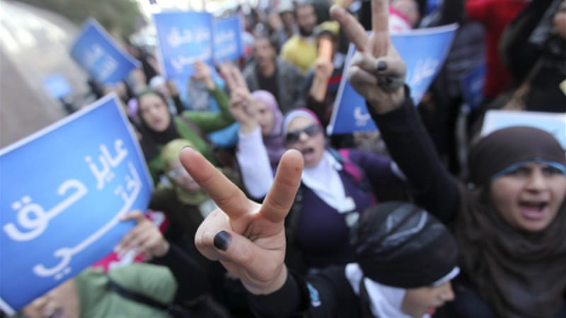 Women hit the streets of Cairo to support Samira Ibrahim in her fight against 'virginity tests' [REUTERS]