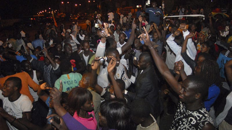 The streets of Dakar erupted when two-term President Wade conceded defeat to his opponent, Macky Sall [EPA]