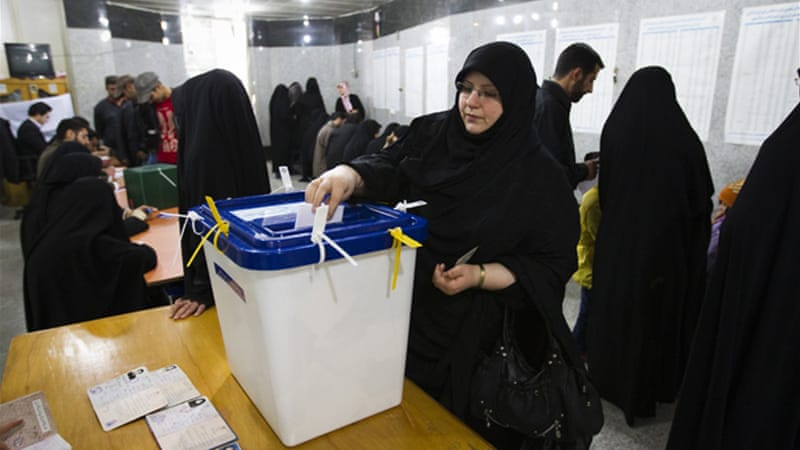 Preliminary results of runoff elections indicate eight seats for Ahmadinejad and 20 for his opponents [Reuters]