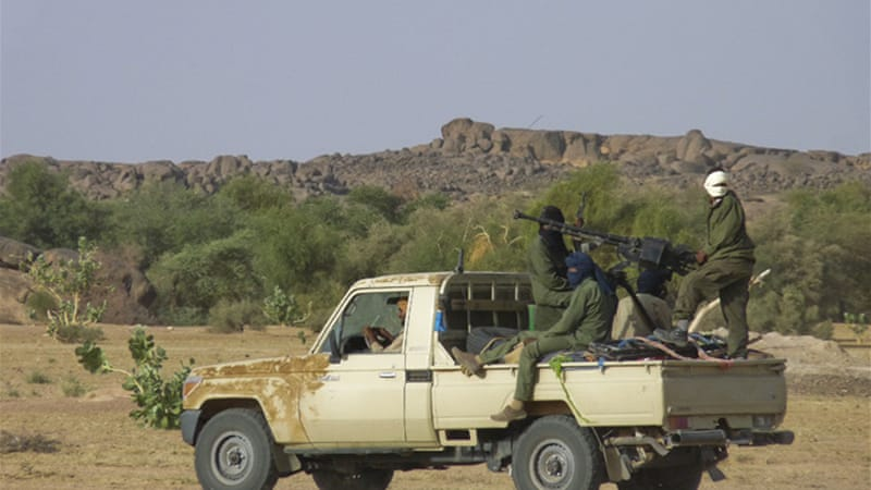 Hundreds of ethnic Tuareg mercenaries, who had fought for both Gaddafi and the NTC rebels, returned home to Northern Mali to restart their own rebellion [EPA]