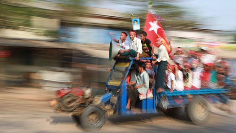 NLD supporters celebrate Aung San Suu Kyi's victory in Kawhmu, south of Yangon [Francis Wade/Al Jazeera]