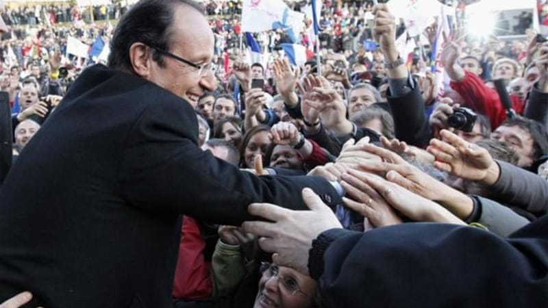 Hollande has urged supporters to give him a clear lead over incumbent Sarkozy in the first round [Reuters]