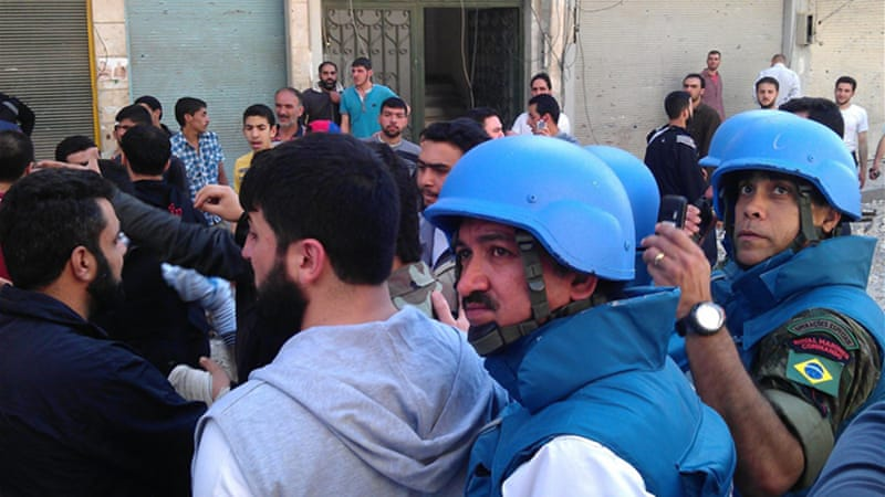 Activists in Homs urged UN team to deploy monitors there, a YouTube video purported to show