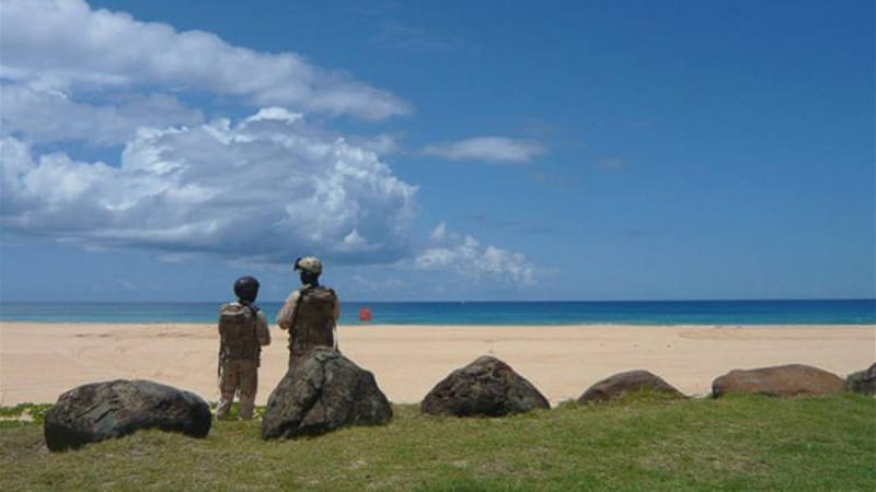 US soldiers overlook Major's Bay at the Pacific Missile Range Facility on the Hawaiian island of Kauai, one of the sites of the Rim of the Pacific (RIMPAC) maritime exercises [Jon Letman/Al Jazeera]