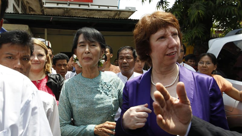 Ashton, right, met Aung San Suu Kyi, centre, just hours after she arrived in Myanmar on Saturday [Reuters]