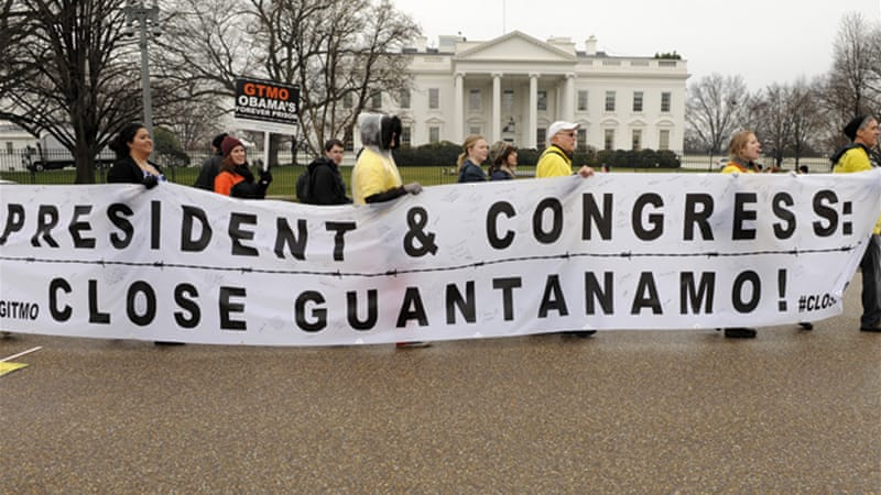 Demonstrators protest against the continued operation of the military detention facility at Guantanamo Bay [EPA]
