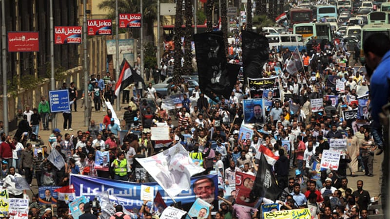 Thousands of people rallied on Friday in central Cairo in support of Hazem Abu Ismail's candidacy [AFP]