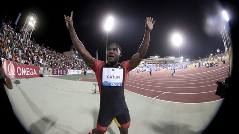 London calling: 2004 Olympic champion Justin Gatlin signals his comeback from a four-year doping ban pipping Jamaican Asafa Powell at the post [REUTERS]
