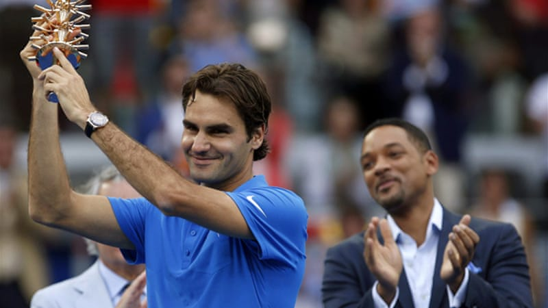 Friends in high places - Federer celebrates his third Spanish crown with the actor Will Smith  [EPA]