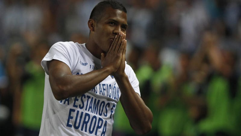 'Thanks fans, we are in Europe' reads the t-shirt of Malaga's Salomon Rondon who scored the winning goal against Sporting Gijon to earn European qualification [REUTERS]
