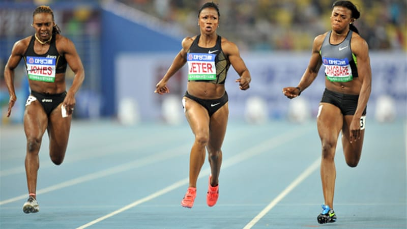 Turbo Jeter: Carmelita (C) crosses finish line ahead of Nigeria's Blessing Okagbare (R) and Laverne Jones (L) [AFP]